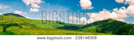 Panorama Of Beautiful Countryside In Summer. Beautiful Landscape With Forested Mountains And Grassy