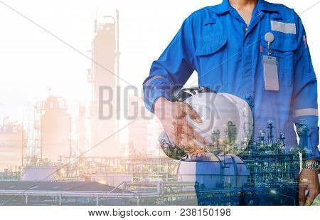 Technician Stand Hand Holding Safety Helmet With Blue Uniform On Petrochemical Industrial Background