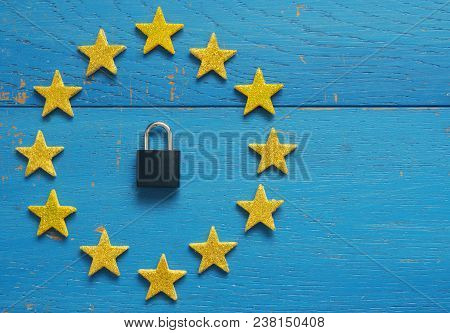 European Union Sign With A Padlock On A Blue Rustic Wooden Background, Dsgvo Concept Image