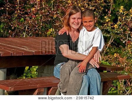 Young Caucasian Mother With Bi-racial 8 Year Old Son Smiling