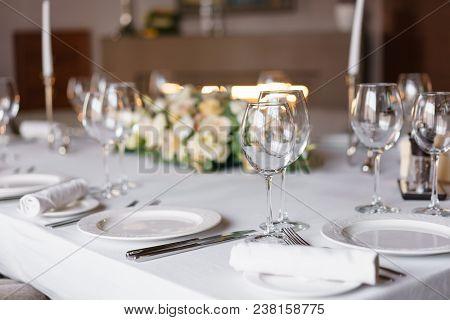 Luxury Wedding Reception. Flower Arrangement On Table In Restaurant. Stylish Decor And Adorning