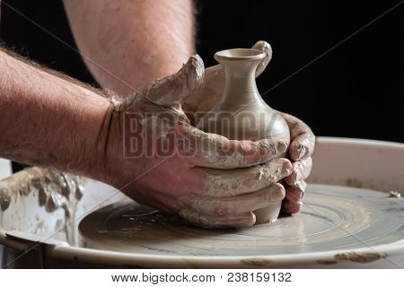 A Very Close Up Photograph Of The Hands Of A Skilled Potter Throwing A Pot On The Wheel And Finishin