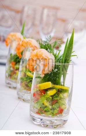 Prawn salad served in the glasses