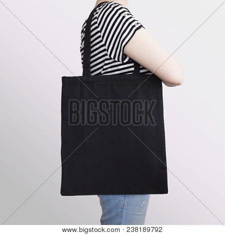 Girl Is Holding Black Cotton Eco Tote Bag, Design Mockup. Handmade Shopping Bag For Girls.
