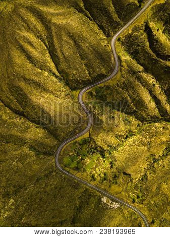 Aerial, Birds Eye View Photo About A Mountain Road, With Red Car.