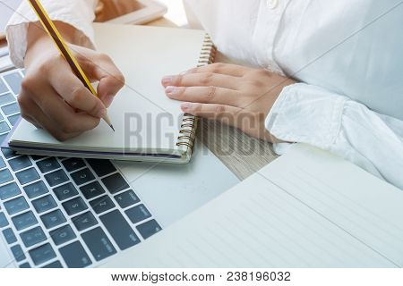 Asian Student Note On Notebook While Learning Online Study Or E Learning Via Laptop Computer. Busine