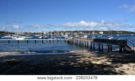 Balgowlah, Australia - Feb 4, 2018. Kids Playing At The Jetty. Yachts In North Harbour At Fourty Bas