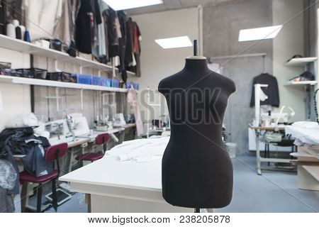 Black Mannequin Without Clothes Standing On Background Sewing Workshop. Design Studio With Fashionab