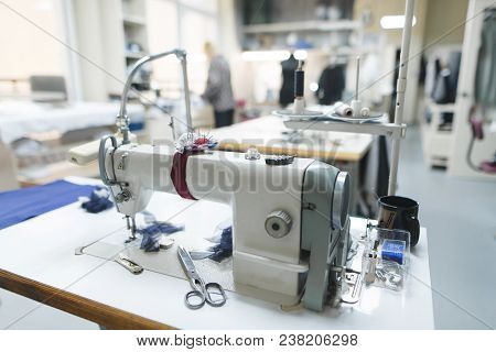 Professional Sewing Machine On The Background Of Atelier Studio. Workplace Of Tailor - Sewing Machin