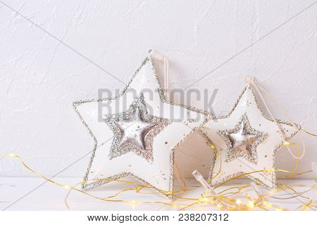 Two Christmas Toys Star On White Textured  Background. Place For Text. Christmas  Decorations.