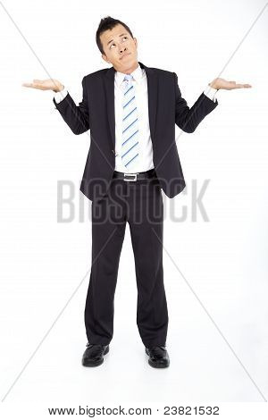 Young businessman shrugging and isolated on white