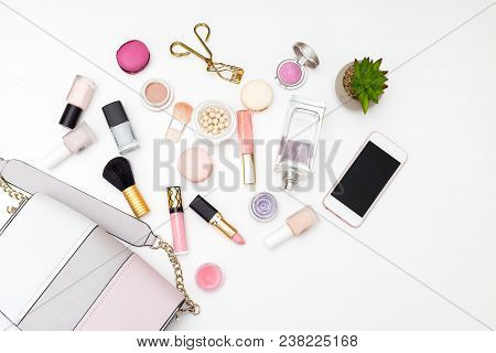 Woman's Swimsuit And Cosmetics Set On A White Background. Flat Lay