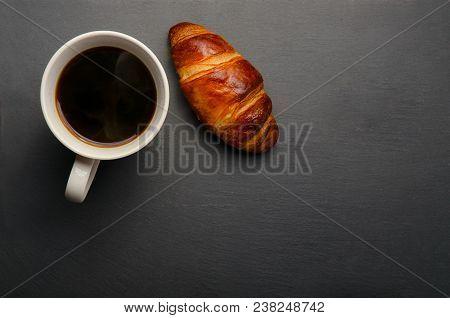 Coffee Mug On Black Background. White Coffee Mug And Croissant On Black Background. Fresh Croissants