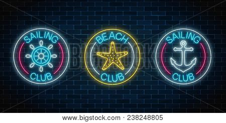 Set Of Three Glowing Neon Signs Of Sailing Club And Beach Club. Summer Leisure Club Emblem With Stee