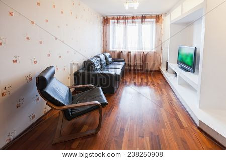 Empty Modern Living Room Interior With Black Leather Chair, Sofa And Tv