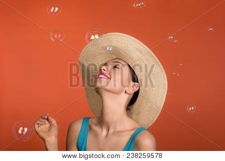 Nice Woman In Panama Looking At Soap Blebs In The Air With Enjoyment. Isolated On Background