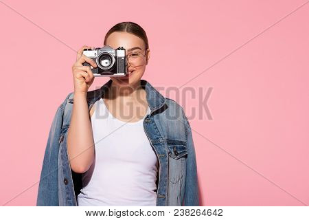 Portrait Of Inspired Female Photographer Making Snap With Joy. She Is Standing And Laughing. Copy Sp