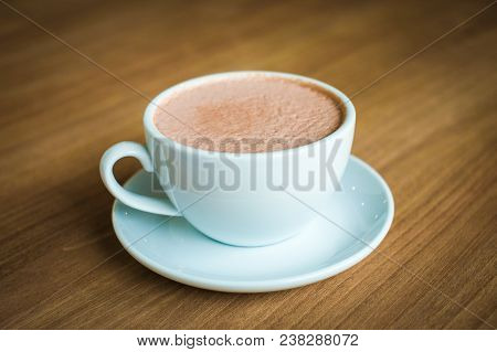 Cup Of Hot Coffee (cappuccino Or Latte) Decorated With Milk Forth On The Surface Serve On Plate For