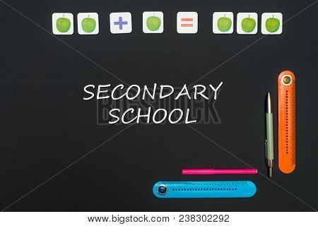 Concept School, Black Art Table With Stationery Supplies With Text Secondary School On Blackboard