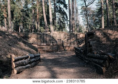 Shelter Of Military Camp. Combat Camp Is Located In The Forest. Visible Pathways Along The Excavated