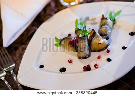 Roasted Eggplant Rolls With Walnut Paste Decorated With Cilantro And Pomegranate Seeds.salad Of Frie