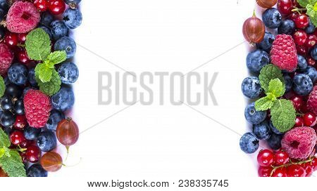 Mix Berries On A White Background. Berries And Fruits With Copy Space For Text. Black-blue And Red F