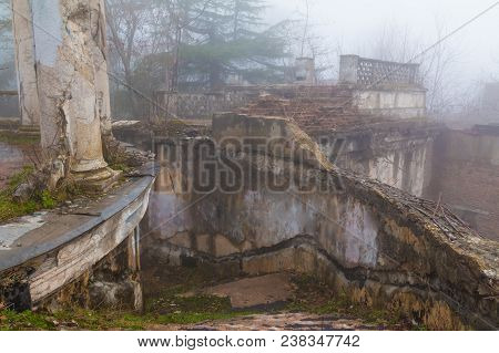 Staircase Of The Abandoned Building Of The Former Restaurant On The Top Of Mount Akhun In Dense Fog,