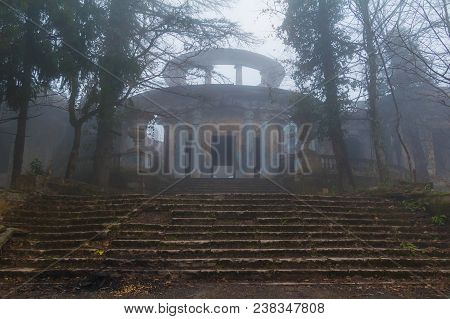 Abandoned Building Of The Former Restaurant On The Top Of Mount Akhun In Dense Fog, Sochi, Russia