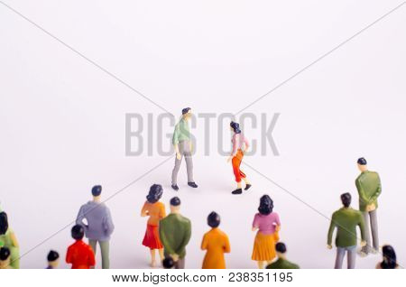 Meeting Of Two People On A White Background. A Man And A Woman Go To Meet Each Other. Romantic Relat