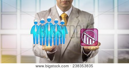 Unrecognizable Hr Manager Is Equating A Team Of Five Blue Collar Workers With A Downward Trend Icon.