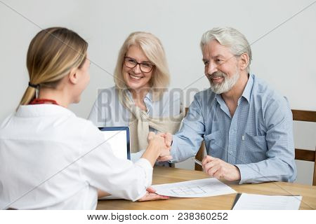 Smiling Senior Couple And Realtor Handshaking Making Real Estate Deal, Older Man And Mortgage Broker