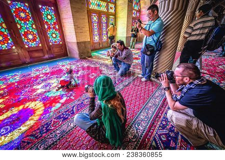 Shiraz, Iran - October 23, 2016: Tourists In Nasir Ol Molk Mosque Also Known As Pink Mosque In Shira