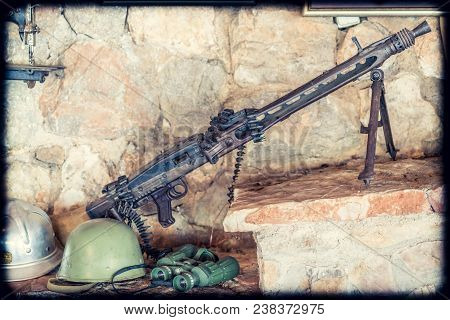 Old disused machine gun used in Balkan war in Serbia on display poster