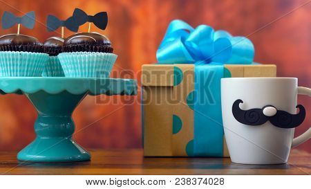 Father's Day Close Up Of Gift, Coffee Mug And Cupcakes.