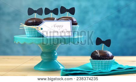 Father's Day Close Up Of Chocolate Cupcakes On Cake Stand On Table.
