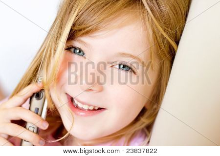 Blond child girl talking mobile telephone smiling happy