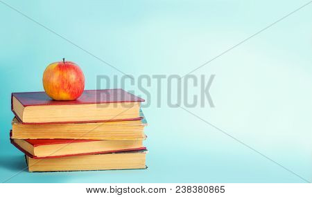 The Concept Of Education. Apple And Books, Blue Background, Place For Text, Back To School, Copy Spa