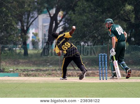 PUCHONG, MALAYSIA - SEPT 24: Malaysia's Hammad Khan delivers a fast bowl in this Pepsi ICC World Cricket League Div 6 finals vs Guernsey at the Kinrara Oval on September 24, 2011 in Puchong, Malaysia.