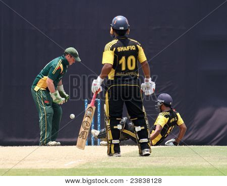 PUCHONG, MALAYSIA - SEPT 24: Malaysia's Mohd Safiq (10) watches Aminuddin slip in this Pepsi ICC World Cricket League Div 6 finals vs Guernsey on Sept 24, 2011 at the Kinrara Oval, Puchong, Malaysia.