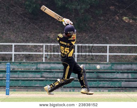 PUCHONG, MALAYSIA - SEPT 24: Malaysia's batsman Aminuddin Ramly bats the ball in this Pepsi ICC World Cricket League Div 6 finals vs Guernsey on Sept 24, 2011 at the Kinrara Oval, Puchong, Malaysia.