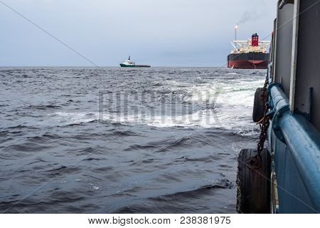 View From Deck Of Ahts Ocean Tug Doing Tanker Lifting Static Towing. Tanker Vessel On Background. Dp