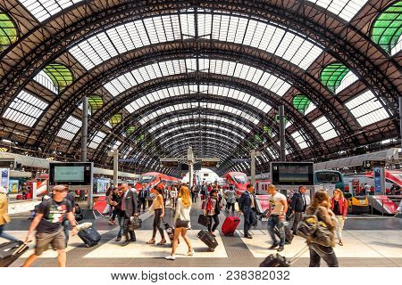 Milan, Italy - May 17, 2017: People Visit The Milan Central Station With High-speed Trains. Crowds O