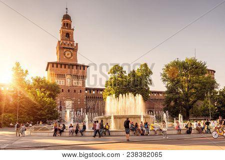 Milan, Italy - May 22, 2017: People Walk Next To Sforza Castle (castello Sforzesco) In Milan. This C