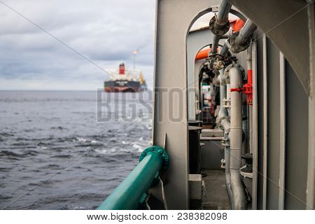 View From Deck Of Ahts Ocean Tug. Tanker Vessel On Background. Dp Posioning Vessels. Oil And Gas Ind