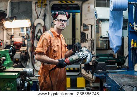 Marine Engineer Working In Ship's Workshop In Engine Control Room