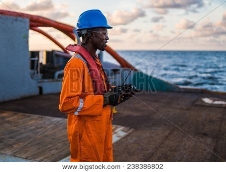 Seaman Ab Or Bosun On Deck Of Vessel Or Ship , Wearing Ppe Personal Protective Equipment - Helmet, C