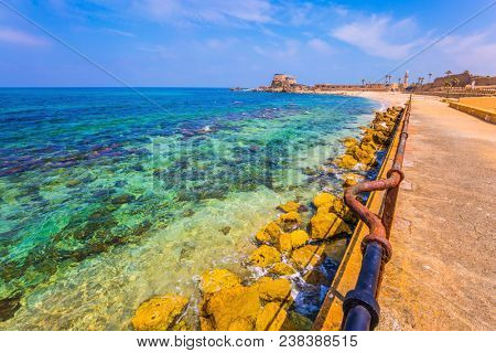 Excursion to the Archaeological Park of the Roman Empire. The port of King Herod in ancient Caesarea and the restored embankment. Concept of active, historical and archaeological tourism