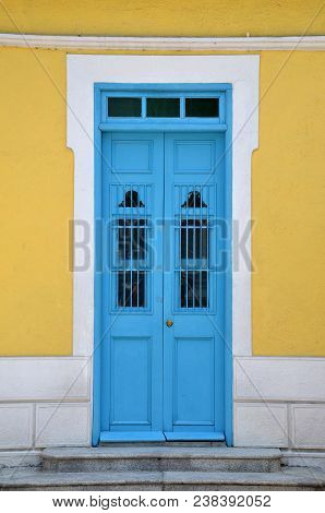 Door Of Portuguese Architecture. Bright And Contrasting Colors.