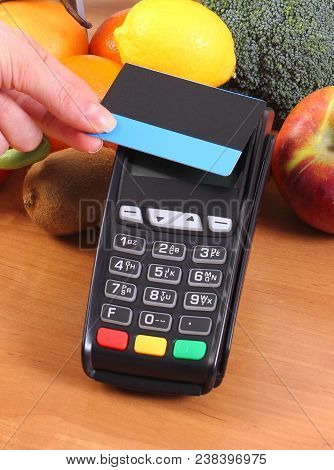 Using Credit Card Reader, Payment Terminal With Contactless Credit Card And Fruits And Vegetables, C