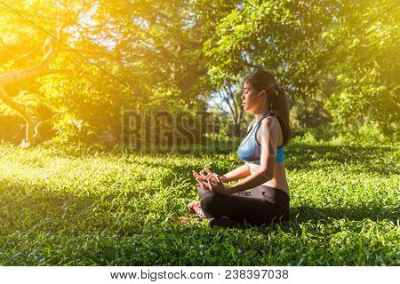 Yoga In The Park, Outdoor With Effect Light, Health Woman, Yoga Woman. Yoga Lifestyle Wellness Healt